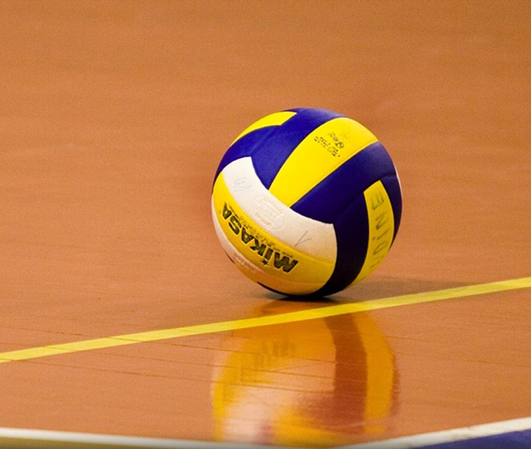 A volleyball on a gym floor